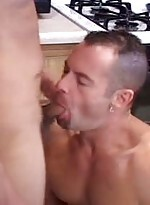 Gay cock sucking action in the kitchen
